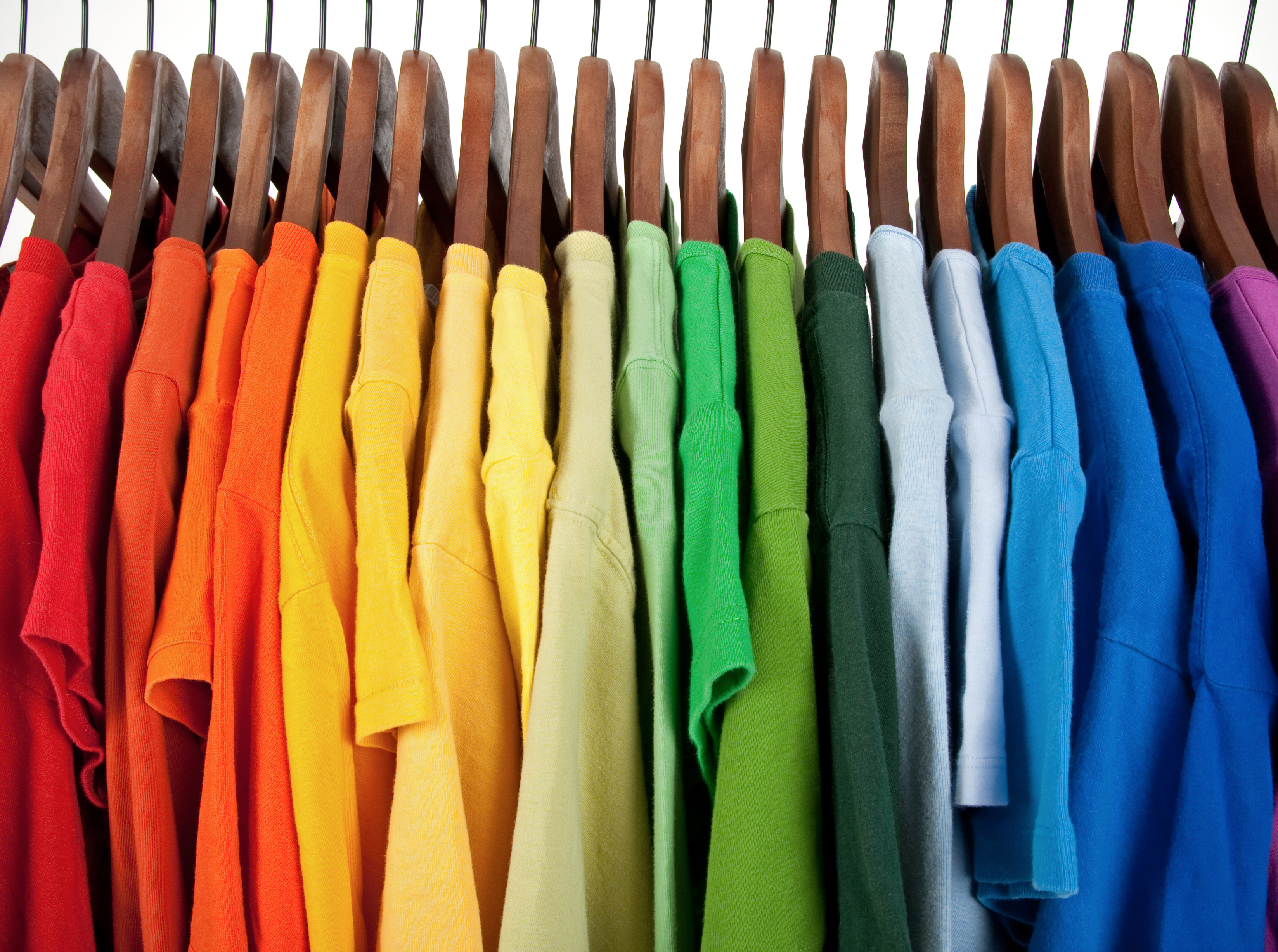 rows of tshirts in bright colours