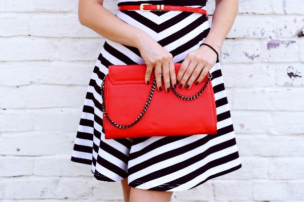 woman holding red bag