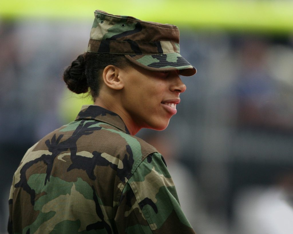 Female in combat dress demonstrating that you are what you wear