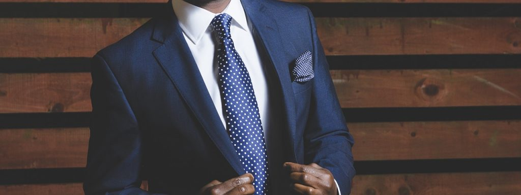 Man wearing a suit to improve his personal brand