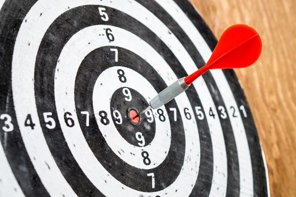 Target with dart to depict knowing your target business area